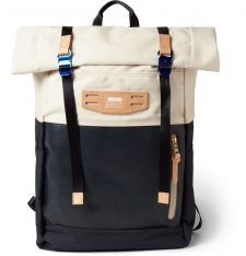 This Master-Piece backpack is panelled in navy and ivory and a mixture of technical canvas and leather for look that combines the graphic with the tactile. What's more, each element is built to last as well, and will only look better with the bumps and scuffs that accompany an adventurous traveller. The rolled top and water-repellent fabric will keep your gear safe and dry in changing weather. Shown here with a Marc by Marc Jacobs blazer, Acne Studios trousers and AMI sneakers.