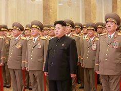 Could Kim Jong-un be trying to emulate his father's trademark look? (AFP/Getty Images)
