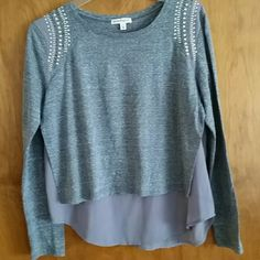 Ladies Top Longsleeve beaded sheer layered top with beaded embellishments.  Cotton blend. Great with leggings or skinny jeans. Tops Blouses