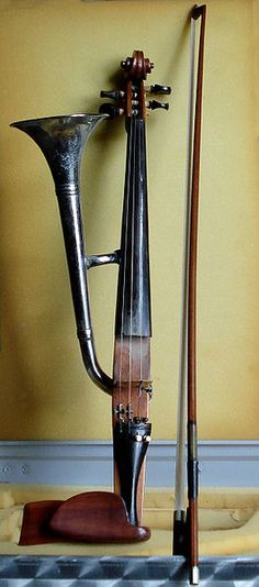 This is one weird instrument. Horn-violin (also called trumpet-violin) with its (normal) violin bow.