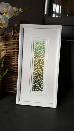 One of a kind signed artwork with sea glass and shell combed from the beautiful Bream Cove, (Nansidwell), here in Cornwall, UK. Every piece is collected by me and is unique to this cove. The photo on the listing shows the bay where I have found these pieces. The picture is arranged in a gradient of green pieces of seaglass. This would make a perfect and one-off gift for any occasion. *PLEASE NOTE THAT THIS IS A FRAMED ORIGINAL - Framed and mounted in a white frame. Frame Size approx: 24cm X…