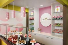 This colorfull cookie store is located in Cincinnati and designed by Frederick Woods Design, Cincinnati. Frederick made the store looks chic, pararrel along the cookies and cupcakes displayed in the store. Pink, lime green, white and other light colors are dominating the store.