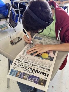 """Reading between the lines: Old-school technique comes to NB school """"Student A.J. Rosales looks for anchor words and sentences in an article in the Herald-Zeitung for the blackout poetry assignment. """" Always cool to see blackout poems in the classroom"""