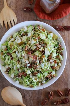 Brussels Sprout Chopped Salad with bacon. candied pecans. pears. blue cheese. and maple-bacon vinaigrette