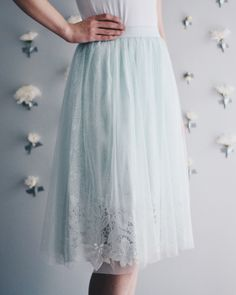 "Beautiful mint tulle skirt with lace underlay. Elastic waistband. 100% polyester Waist: small: 26"", medium: 28"", large: 30"" + elastic waist stretch Full Length: small- 26"", medium- 26"", large-27"" 
