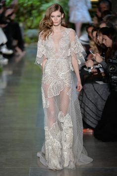 Mixed sheer fabrications with embellished lace overlay placement...