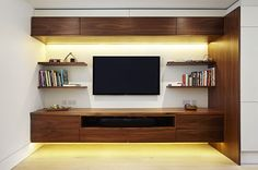 Fraher and Co designed the shelving to lighten in tone as one ascends through the house. It moves from black walnut to lighter oak to wood that's painted white. Living Room Colors, Living Room Designs, Muebles Rack Tv, Tv Wanddekor, Modern Tv Wall Units, Custom Shelving, Tv Wall Decor, Living Room Storage, Living Room With Fireplace