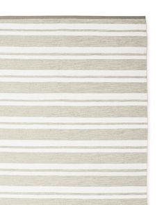 Who can resist a good stripe? They're timeless, versatile, and add nice energy to your mix. Woven from the finest Perennials® Performance fabric yarns, this rug has all that and more. It resists stains, rain, and moisture season after season – and the colors permeate to the fiber core for a vibrant beauty that won't fade. Unexpectedly inviting – not rigid – for something so durable,  it looks just as good in the dining room as it does on the deck.