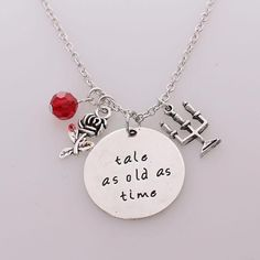 Hand stamped silver charm 'TALE AS OLD AS TIME', It is adorned with a red swarovski crystal charm & mirror & rose charm. Set on to a 18 silver plated chain. Please allow days for shipping Cute Jewelry, Metal Jewelry, Jewelry Art, Jewellery, Beauty And The Beast Party, Disney Beauty And The Beast, Disney Engagement Rings, Deco Disney, Silver Jewelry Cleaner
