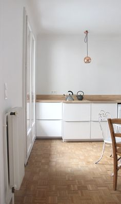 minimal white and wooden kitchen