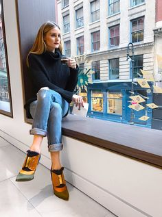 WHAT A VIEW Olivia Palermo strikes a pose while holiday shopping at the Nespresso boutique in N.Y.C.'s Soho neighborhood.