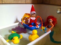 The elf and Ariel hanging out in the bath top. The elf is fishing and hooked Flounder. Oh no!!