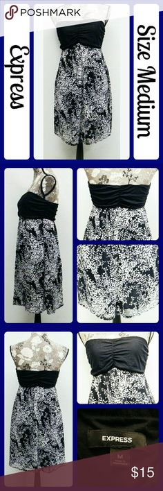 Sz Med Express Dress, Black and White, Super Cute! EUC Worn once , the top is a very soft t-shirt material that is rouched down the center. It has elastic arount the top to hold it up. The whole dress is completely lined and the bottom has a sheer overly with a beautiful floral design. It is very flowy and flattering. From a smoke-free home. No rips, snaps, stains, tears, or wear at all. (T126) Express Dresses Strapless