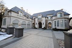 Stunning French Style Home finished with a smooth face indiana limestone and imitation slate roof #JTFHomes #customhomebuilder #homesideas #indianalimestone #toronto http://www.jtfhomes.com/