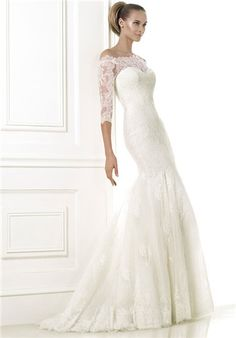 Mermaid dress in embroidered tulle with Chantilly lace appliqués. Bodice with wrap-around neckline a