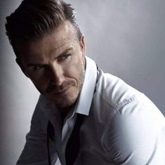 Throughout the years, Beckham has had different styles of hair that have gone from short hair to medium, to long hair. Here are 45 best David Beckham haircuts. David Beckham Haircut, David Beckham Style, Oval Face Hairstyles, All Hairstyles, Pompadour Style, The Beckham Family, Insta Models, Haircuts For Men, Men's Haircuts