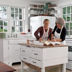 This neutral kitchen uses pieces salvaged from an older space as a vintage center island and work station