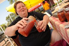 Alisa pours bloody mary mix for tasting at the Greenwood Farmers' Market by Southern Foodways Alliance, via Flickr