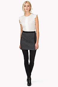 The Bruna skirt is made from a wonderfully warm wool blend and is fully lined. It has a hint of stretch for extra comfort and it sits in a regular fit. Zip at back waist. Small TH metal badge on left hem.<br/><br/>Our model is 1.76m and is wearing a size S skirt.
