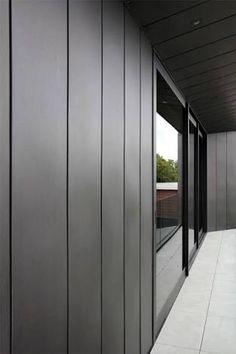 James hardie axon cladding charcoal grey black windows