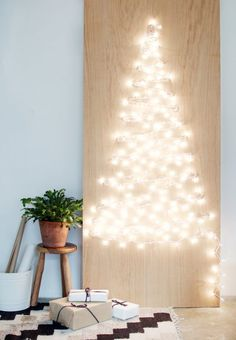 Easy DIY: alternative Christmas tree from Geneva Vanderzeil of A Pair and a Spare. She used screws/plywood/string/lights to create a glowing Christmas tree you can still gather around. Christmas Tree Made Of Lights, Pencil Christmas Tree, Christmas Backdrops, How To Make Christmas Tree, Alternative Christmas Tree, Small Christmas Trees, Xmas Lights, Christmas Mom, Modern Christmas