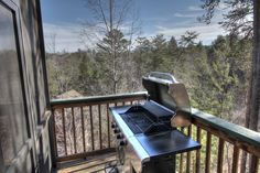 Sasquatch Ridge Pigeon Forge vacation rental cabin - the BBQ grill on the deck is attached to the natural gas of the cabin - no running out of gas in the middle of cooking!