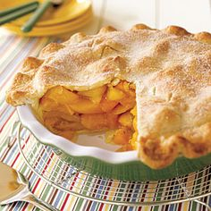 Nothing says summertime like a homemade peach pie. The filling mixture is thickened with both tapioca and cornstarch, and a sprinkling of sugar over the crust adds a bit more sweetness.