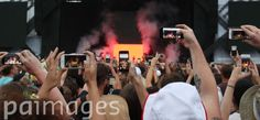 People in the audience using smartphones to record Kanye West performing on the Main Stage at the Wireless Festival in Finsbury Park, north London.