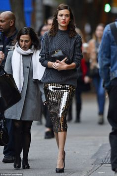 She's in fashion: Alexa Chung looks chic in a jumper and glitzy skirt as she arrives for a book signing of her scrapbook autobiography It at...