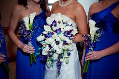 Love the white and blue. Go with stargazer lilies or white roses, but love the blue bridesmaids dresses! They look great all together :)