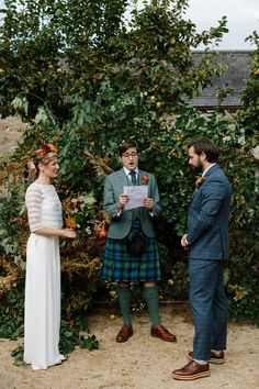 A bright and colourful outdoor Autumn wedding ceremony, captured by Caro Weiss photography. Bride wears a Charlie Brear trouser suit and her bridesmaids wear short orange dresses and carry colourful bouquets. Wedding Styles, Wedding Blog, Wedding Ideas, British Wedding, Wedding Jumpsuit, Autumn Wedding, Dresses Uk, Traditional Dresses, Mother Of The Bride