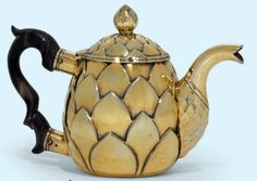 A CONTINENTAL SILVER-GILT TEA-POT APPARENTLY UNMARKED, MID-18TH CENTURY In the form of an artichoke, the hinged cover with an artichoke finial, with a wood handle and a part-facetted spout. Christies    --Shared by WhatnotGems.Etsy.com Shop Etsy!