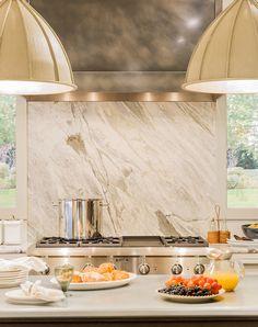 marble slab backsplash and stunning range hood