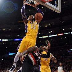 Dwight Howard of the Los Angeles Lakers dunks over J. Hickson of the Portland Trail Blazers during a win at Staples Center on December 2012 in Los Angeles, California. Best Dunks, Dwight Howard, Portland Trailblazers, Trail Blazers, Nba Players, Best Player, Los Angeles Lakers, Basketball Court, Staples Center
