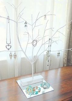 Tree Branch Jewelry Display....  And of course the best part is, it's FREE and you can paint it to match your own decor! Brilliant!