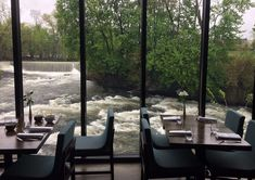 Right along Fishkill Creek in the Hudson Valley, New York is home to a hotel and restaurant that overlooks endless waterfalls at the Roundhouse. Truffle Popcorn, New York January, Pork Cheeks, New York Attractions, New York Food, Restaurant New York, Travel Money, Floor To Ceiling Windows, Round House