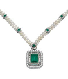 EMERALD, SEED PEARL, AND DIAMOND NECKLACE, CIRCA 1910. The step-cut emerald, collet-set within an open-work frame of floral design decorated with millegrain-set circular-, single-cut, and rose diamonds, the necklace composed of a band of woven seed pearls highlighted with emerald and diamond motifs, length approximately 460mm, central pendant may be worn as a brooch, fitted case by Koch with compartment including brooch fitting and screw driver.