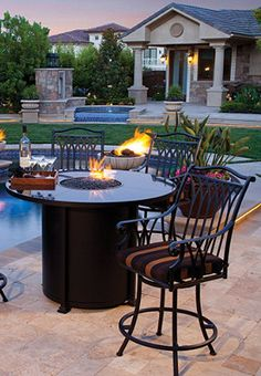 This elevated fire pit is perfect for gatherings poolside or on the patio.