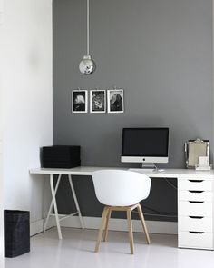 Clean workspace with contrasting wall. HAY chair to be comfortable all day. Mind the sublte personal items on the wall, makes working very pleasant yet doesn't distract you from the tasks.