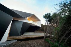 Superb Geometric Home in Australia  The architect McBride Charles Ryan mixed his field of predilection with sculpture for his project Klein Bottle House that he decided to build in Rye near Melbourne in Australia. From the outside as well as from the inside the outlines of the building are extremely raw and give life to very geometric shapes on the walls the windows and the ceiling. The rendering finally almost looks like sculpture as each curve was studied with fastidiousness and both…