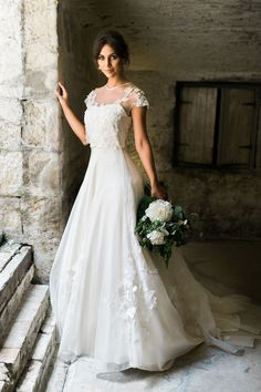 Cap sleeve wedding dress with floral applique | Two People Photography