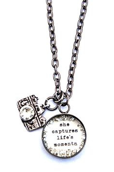 .. Handcrafted necklace with rhinestone camera .. -small hand glittered charm (18mm) reads she captures lifes moments please choose plating