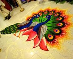 Peacock rangoli design got prime attention in all types of festivals. Here are the 25 best Peacock Rangoli Designs for all occasions, and these looks are very vibrant and colorful. Rangoli Designs Peacock, Easy Rangoli Designs Diwali, Rangoli Designs Latest, Simple Rangoli Designs Images, Rangoli Patterns, Rangoli Border Designs, Rangoli Ideas, Colorful Rangoli Designs, Diwali Rangoli