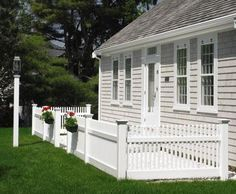 3ft Nantucket Fence - Our 3' high Nantucket hollow vinyl fence fronts this property with a neat and appealing understated elegance.