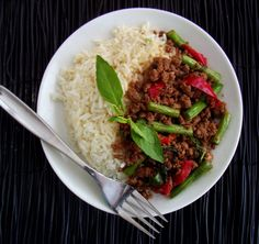 thai basil beef  3 T fish sauce 1 T soy sauce 1 t lime juice 1 T brown sugar sauteed... 1 T cooking oil (canola works fine) 2 large cloves of garlic, finely chopped 1-2 Thai chilies, finely chopped (jalapeños or serranos will work as well) 1 lb ground sirloin 1/2 lb fresh green beans (cut into 1″ pieces) 1/2 c red bell pepper strips tossed in... basil/thai basil