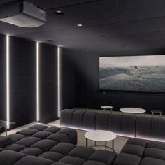 Home theaters quarto Sierra Vista Theater with Contemporary Home Theater and Black Walls and Ceiling Dark Gray Sofa Linear Lights Recessed Lighting Round Stone Coffee Table U Shaped Couch Home Theater Room Design, Home Theater Rooms, Home Theater Seating, Theater Seats, Cinema Room Small, Home Cinema Room, Salas Home Theater, At Home Movie Theater, Home Theater Lighting