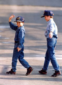 Princes William and Harry wave as they head back to the royal yacht Britannia on Oct. 22, 1991