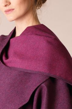 Our Donegal Tweed wraps and shawls are a one size fit all garment that will suit all shapes and sizes. The stunning reversible style of this cape makes this cape truely unique. #donegaltweed #cape #wool #tweed #irishfashion #wearingirish #shawl Irish Fashion, Raspberry Color, Wool Cape, Capes For Women, Donegal, Fit S, One Size Fits All, Chic Outfits, Shawls