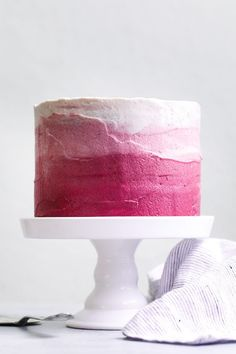The BEST gluten-free chocolate cake topped with naturally pink ombre hibiscus cream cheese frosting. Tender and rich dark chocolate cake with tart frosting!