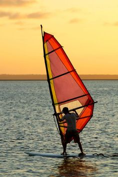 Watching the sunset while wind-surfing. <3